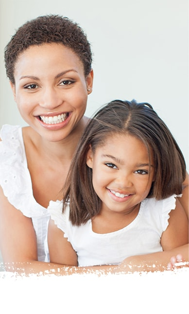 Smiling African-American woman with her daughter