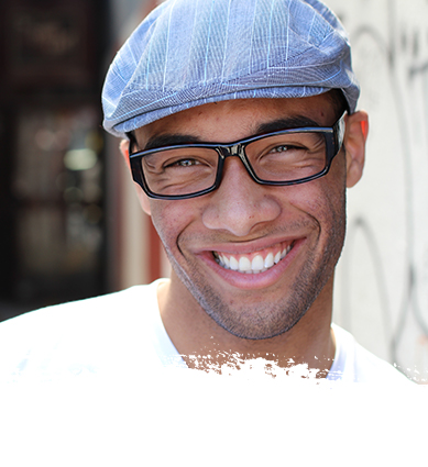 Man with glasses smiling at camera